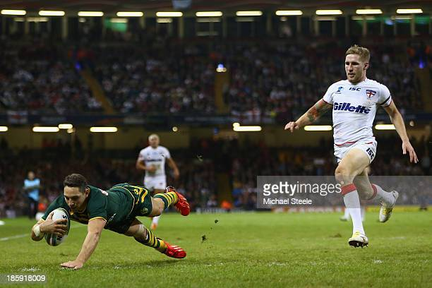 Billy Slater of Australia scores a try as Sam Tomkins of England looks on during the Rugby League World Cup Group A match between Australia and...