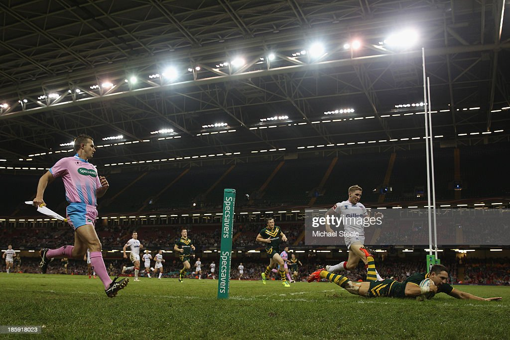 Billy Slater of Australia scores a try as Sam Tomkins of England gives chase during the Rugby League World Cup Group A match between Australia and...