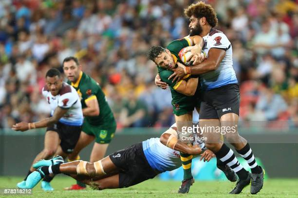 Billy Slater of Austrlia is tackled during the 2017 Rugby League World Cup Semi Final match between the Australian Kangaroos and Fiji at Suncorp...