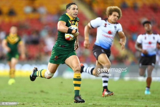 Billy Slater of Austrlia makes a break to score a try during the 2017 Rugby League World Cup Semi Final match between the Australian Kangaroos and...