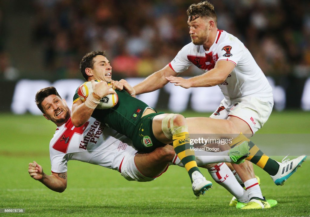 Billy Slater of the Kangaroos is tackled by Gareth Widdop of England during the 2017 Rugby League World Cup match between the Australian Kangaroos and England at AAMI Park on October 27, 2017 in Melbourne, Australia.