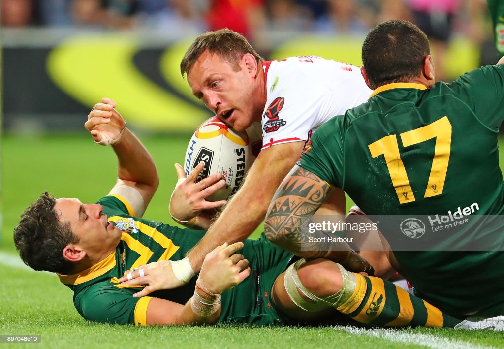Billy Slater of the Kangaroos performs a try saving tackle as James Roby of England attempts to score a try during the 2017 Rugby League World Cup match between the Australian Kangaroos and England at AAMI Park on October 27, 2017 in Melbourne, Australia.