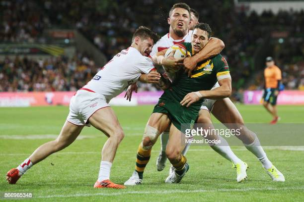 Billy Slater of the Kangaroos still scores a try after a heavy tackle from Sam Burgess of England during the 2017 Rugby League World Cup match...