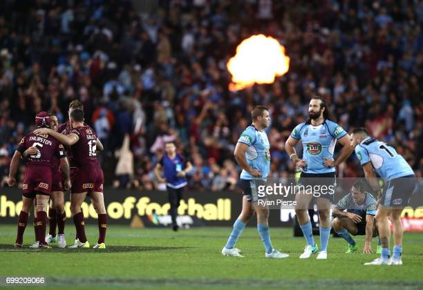 Billy Slater of the Maroons celebrates as Mitchell Pearce of the Blues looks dejected after during game two of the State Of Origin series between the...