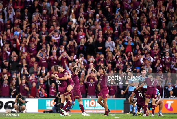 Billy Slater of the Maroons celebrates victory with team mates after game three of the State Of Origin series between the Queensland Maroons and the...