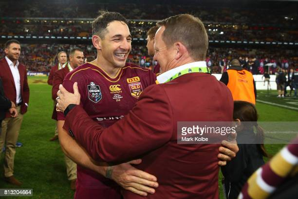 Billy Slater of the Maroons hugs coach Kevin Walters after winning game three of the State Of Origin series between the Queensland Maroons and the...