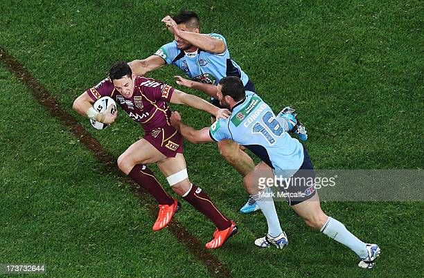Billy Slater of the Maroons is tackled by Bord Cordner and James Tamou of the Blues during game three of the ARL State of Origin series between the...