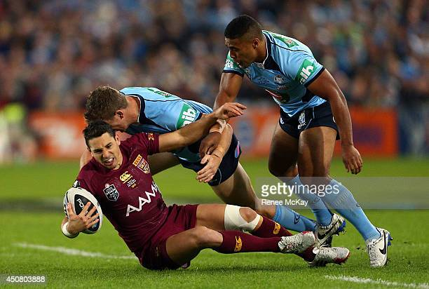 Billy Slater of the Maroons is tackled by Ryan Hoffman and Michael Jennings during game two of the State of Origin series between the New South Wales...