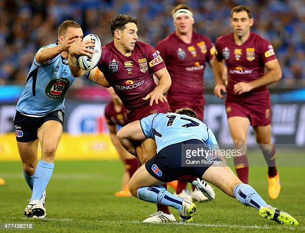 Billy Slater of the Maroons looks to pass whilst being tackled by Josh Jackson of the Blues during game two of the State of Origin series between the...