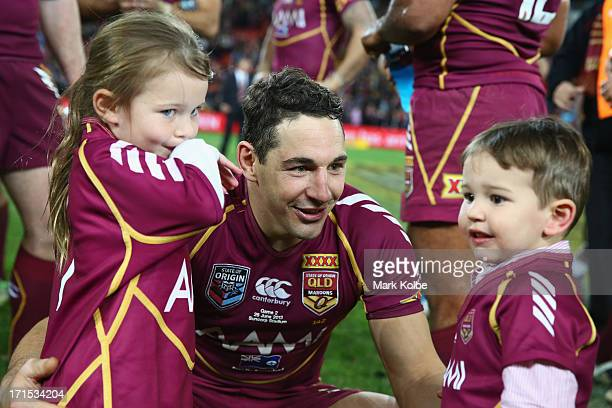 Billy Slater of the Maroons speaks to his children as he celebrates winning game two of the ARL State of Origin series between the Queensland Maroons...