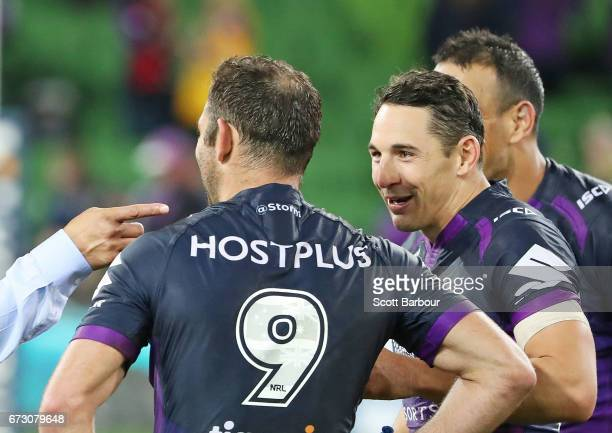 Billy Slater of the Melbourne Storm talks with Cameron Smith of the Melbourne Storm after the round eight NRL match between the Melbourne Storm and...