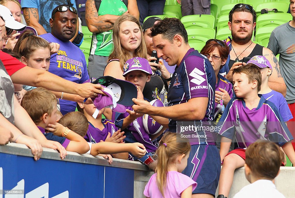 Billy Slater of the Storm along with his daughter Tyla Rose and his son Jake greet fans after the round one NRL match between the Melbourne Storm and the St George Illawarra Dragons at AAMI Park on March 10, 2013 in Melbourne, Australia.