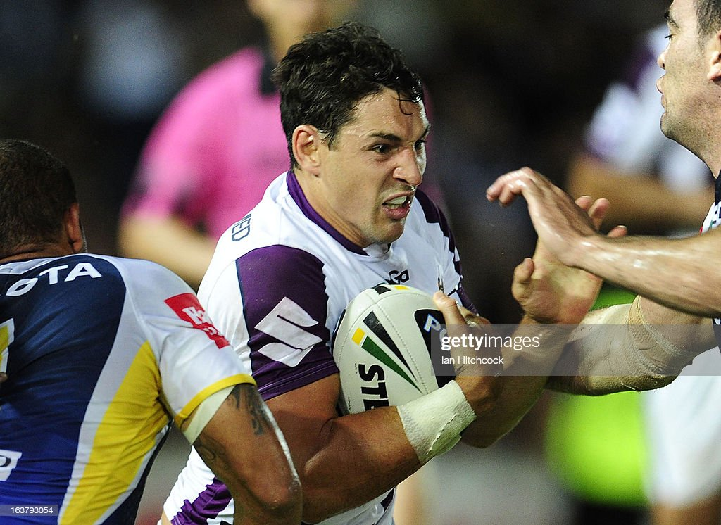 <a gi-track='captionPersonalityLinkClicked' href=/galleries/search?phrase=Billy+Slater&family=editorial&specificpeople=171206 ng-click='$event.stopPropagation()'>Billy Slater</a> of the Storm attempts to break through the Cowboys defence during the round two NRL match between the North Queensland Cowboys and the Melbourne Storm at 1300SMILES Stadium on March 16, 2013 in Townsville, Australia.