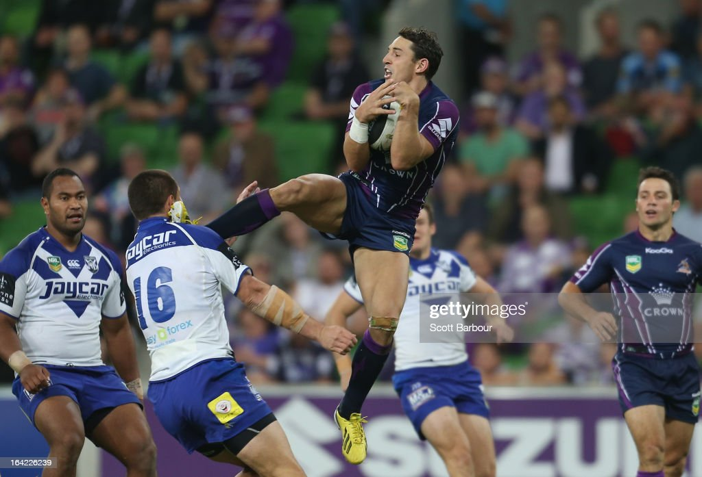 Billy Slater of the Storm catches a high ball and kicks David Klemmer of the Bulldogs in the head during the round three NRL match between the Melbourne Storm and the Canterbury Bulldogs at AAMI Park on March 21, 2013 in Melbourne, Australia.