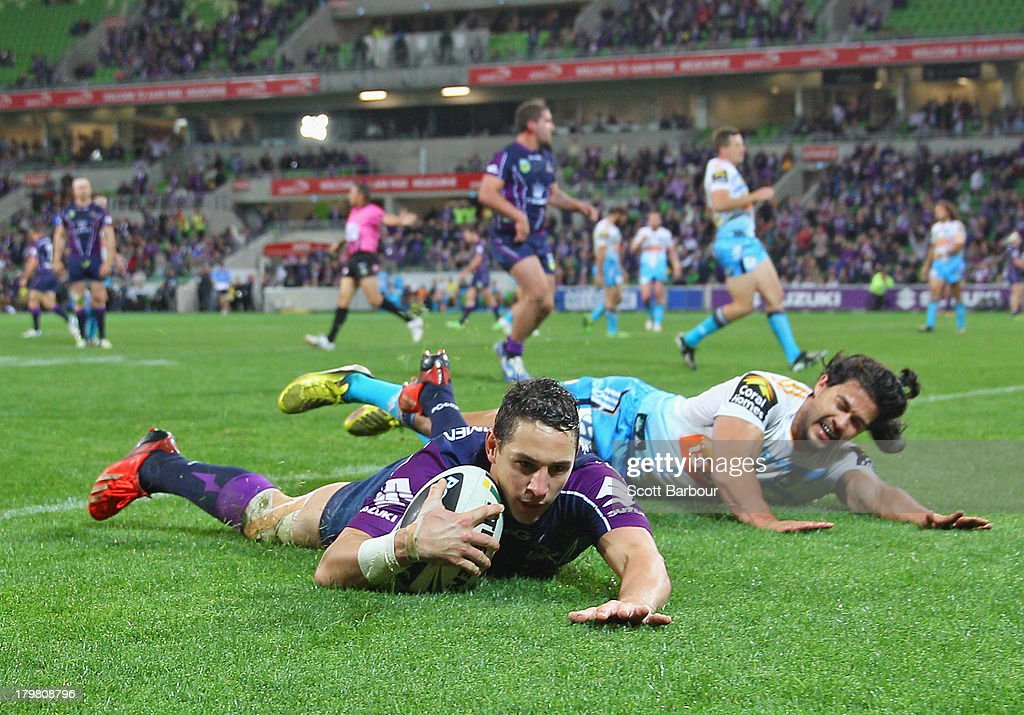 Billy Slater of the Storm dives in to score a try which was later disallowed during the round 26 NRL match between the Melbourne Storm and the Gold...