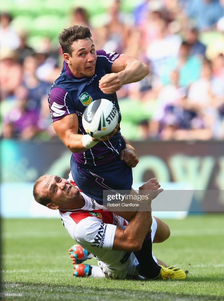 <a gi-track='captionPersonalityLinkClicked' href=/galleries/search?phrase=Billy+Slater&family=editorial&specificpeople=171206 ng-click='$event.stopPropagation()'>Billy Slater</a> of the Storm is challenged by Jason Nightingale of the Dragons during the round one NRL match between the Melbourne Storm and the St George Illawarra Dragons at AAMI Park on March 10, 2013 in Melbourne, Australia.