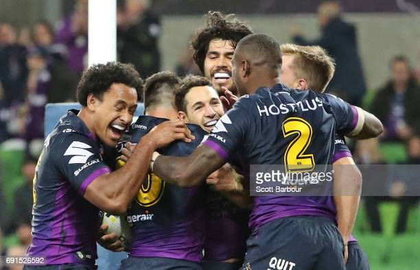 Billy Slater of the Storm is congratulated by his teammates after scoring a try during the round 13 NRL match between the Melbourne Storm and the...