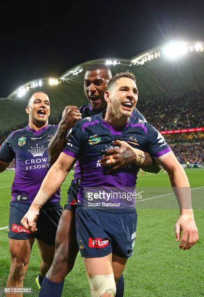 Billy Slater of the Storm is congratulated by Suliasi Vunivalu and his teammates after scoring a try during the NRL Preliminary Final match between...