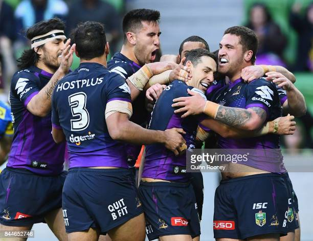 Billy Slater of the Storm is congratulated by team mates after scoring a try during the NRL Qualifying Final match between the Melbourne Storm and...
