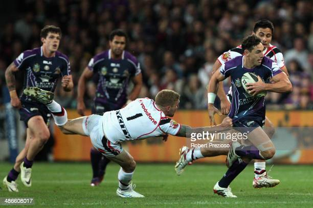 Billy Slater of the Storm is tackled by Sam Tomkins of the Warriors during the round 8 NRL match between the Melbourne Storm and the New Zealand...