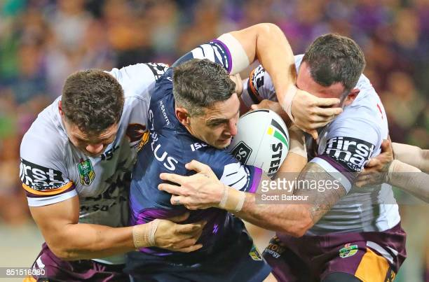 Billy Slater of the Storm is tackled during the NRL Preliminary Final match between the Melbourne Storm and the Brisbane Broncos at AAMI Park on...