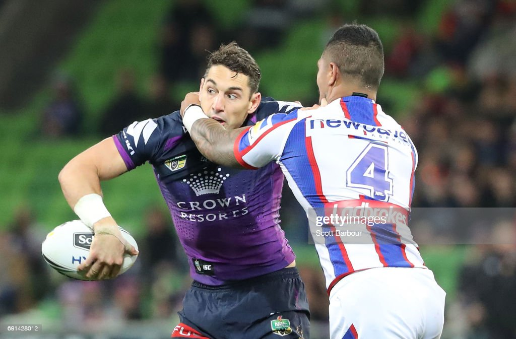 Billy Slater of the Storm is tackled during the round 13 NRL match between the Melbourne Storm and the Newcastle Knights at AAMI Park on June 2, 2017 in Melbourne, Australia.