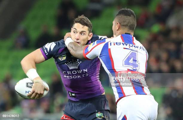 Billy Slater of the Storm is tackled during the round 13 NRL match between the Melbourne Storm and the Newcastle Knights at AAMI Park on June 2 2017...
