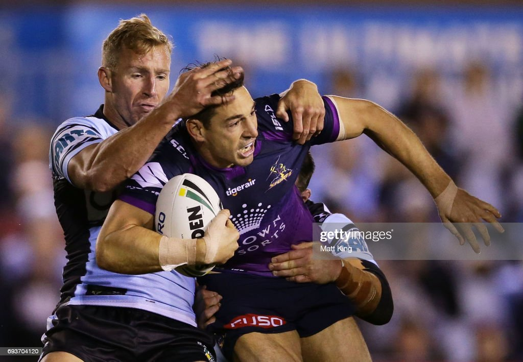Billy Slater of the Storm is tackled during the round 14 NRL match between the Cronulla Sharks and the Melbourne Storm at Southern Cross Group Stadium on June 8, 2017 in Sydney, Australia.