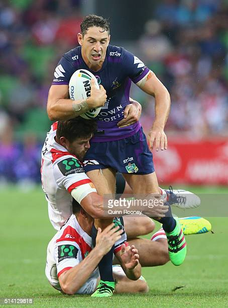 Billy Slater of the Storm is tackled during the round one NRL match between the Melbourne Storm and the St George Illawarra Dragons at AAMI Park on...
