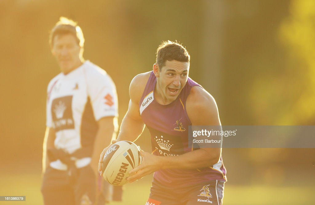 <a gi-track='captionPersonalityLinkClicked' href=/galleries/search?phrase=Billy+Slater&family=editorial&specificpeople=171206 ng-click='$event.stopPropagation()'>Billy Slater</a> of the Storm passes the ball as Storm coach Craig Bellamy (L) looks on during a Melbourne Storm NRL training session at Gosch's Paddock on February 11, 2013 in Melbourne, Australia.