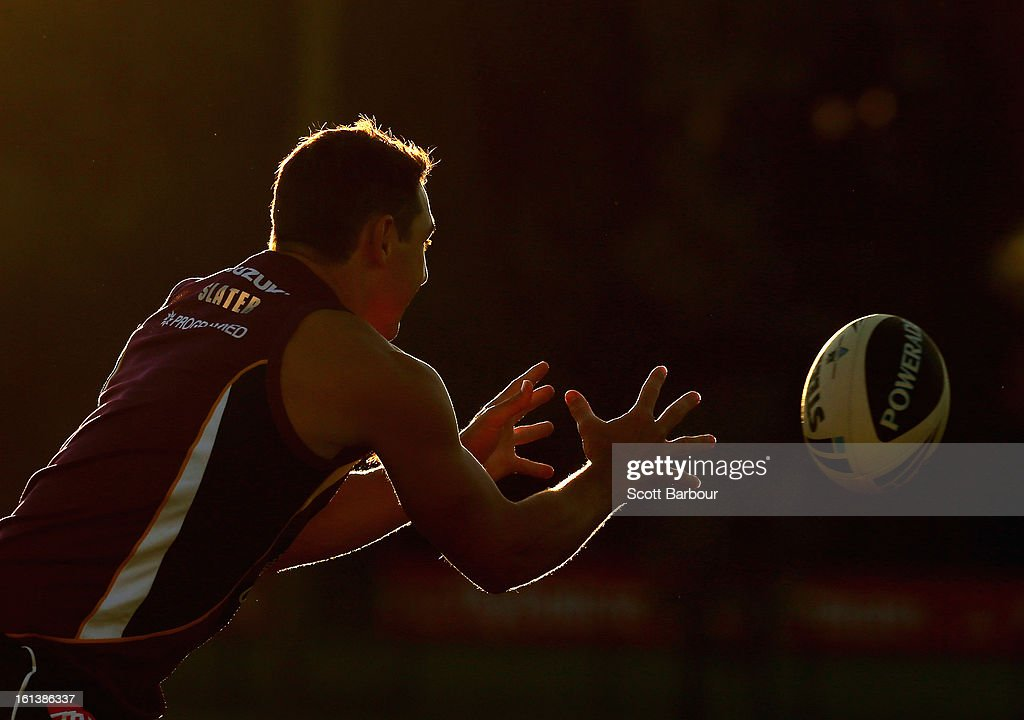 Billy Slater of the Storm passes the ball during a Melbourne Storm NRL training session at Gosch's Paddock on February 11 2013 in Melbourne Australia