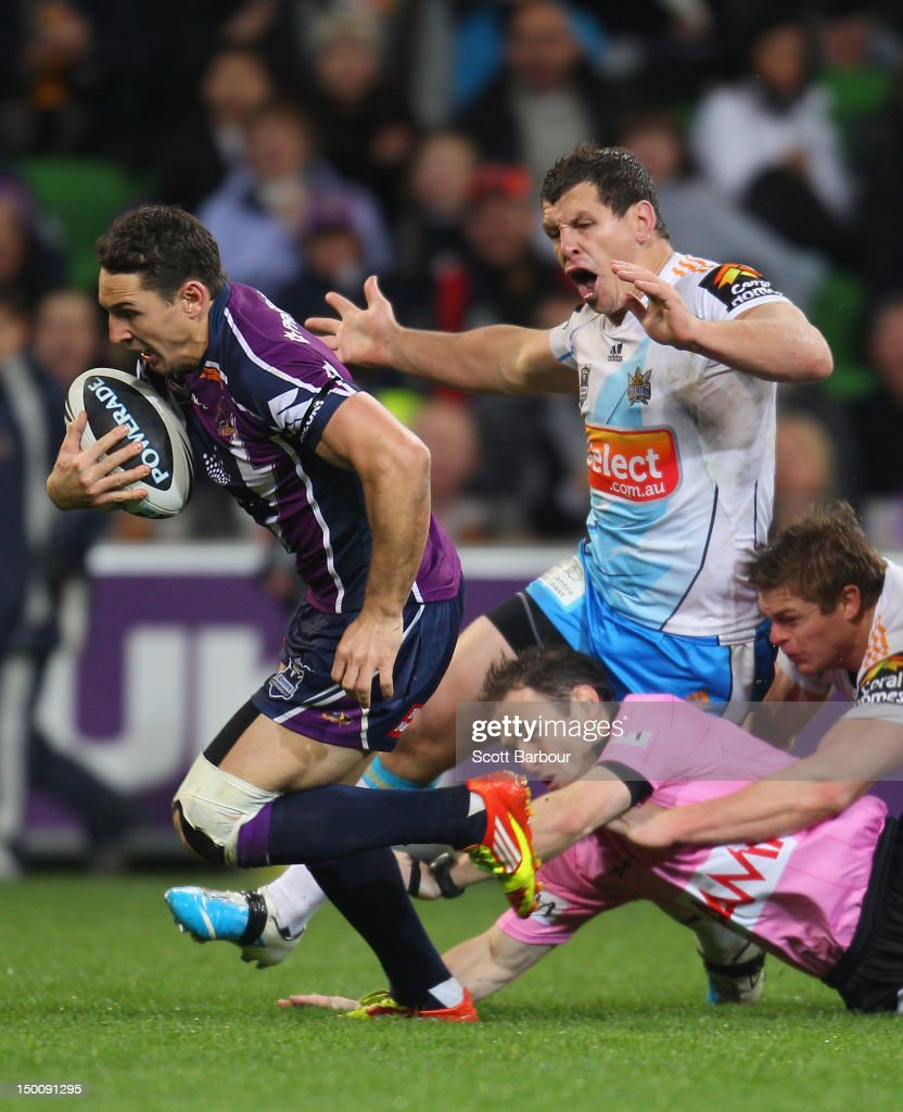 Billy Slater of the Storm runs in for a try as the referee falls over during the round 23 NRL match between the Melbourne Storm and the Gold Coast Titans at AAMI Park on August 10, 2012 in Melbourne, Australia.