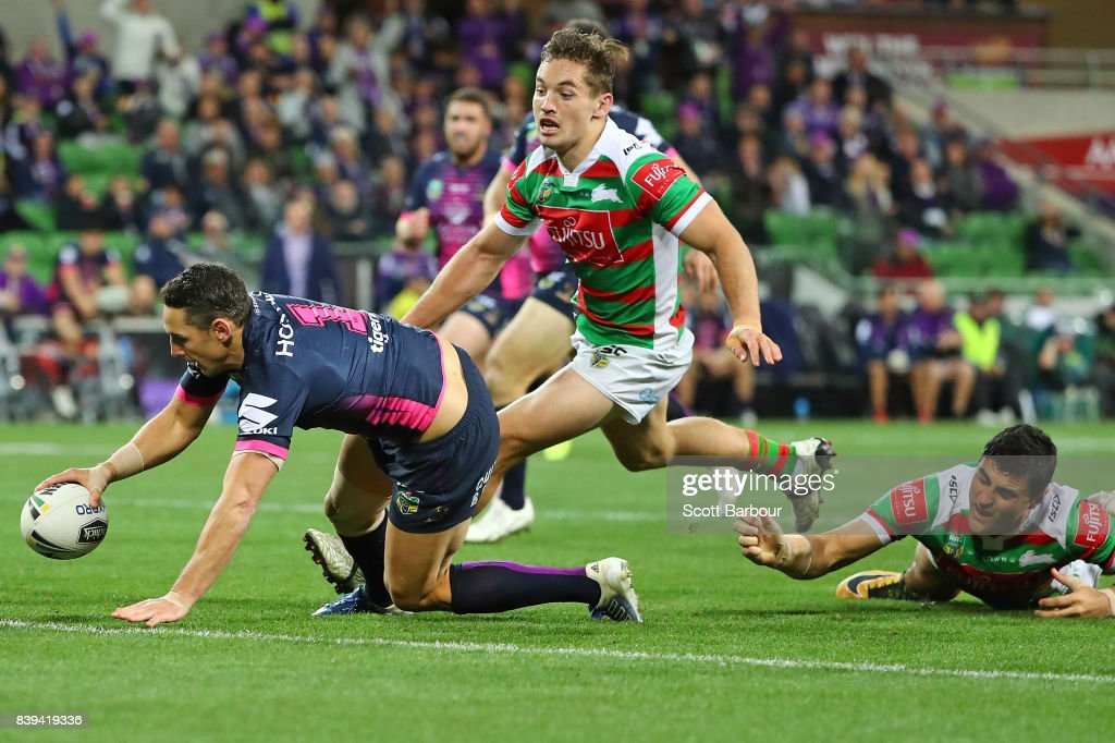 Billy Slater of the Storm runs in to score a try during the round 25 NRL match between the Melbourne Storm and the South Sydney Rabbitohs at AAMI Park on August 26, 2017 in Melbourne, Australia.
