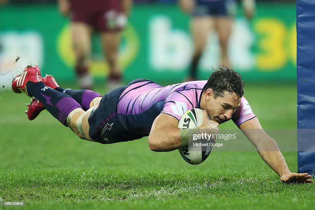 <a gi-track='captionPersonalityLinkClicked' href=/galleries/search?phrase=Billy+Slater&family=editorial&specificpeople=171206 ng-click='$event.stopPropagation()'>Billy Slater</a> of the Storm scores a try during the round nine NRL match between the Melbourne Storm and the Manly-Warringah Sea Eagles at AAMI Park on May 10, 2014 in Melbourne, Australia.
