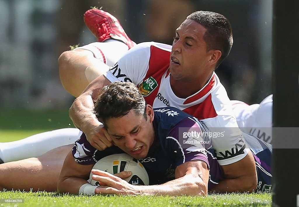<a gi-track='captionPersonalityLinkClicked' href=/galleries/search?phrase=Billy+Slater&family=editorial&specificpeople=171206 ng-click='$event.stopPropagation()'>Billy Slater</a> of the Storm scores the first try of the game during the round one NRL match between the Melbourne Storm and the St George Illawarra Dragons at AAMI Park on March 10, 2013 in Melbourne, Australia.