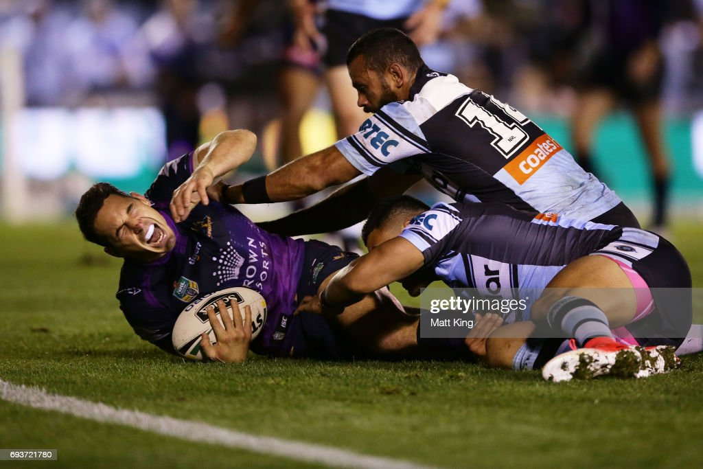 Billy Slater of the Storm shows discomfort and appears to be injured in a tackle during the round 14 NRL match between the Cronulla Sharks and the Melbourne Storm at Southern Cross Group Stadium on June 8, 2017 in Sydney, Australia.