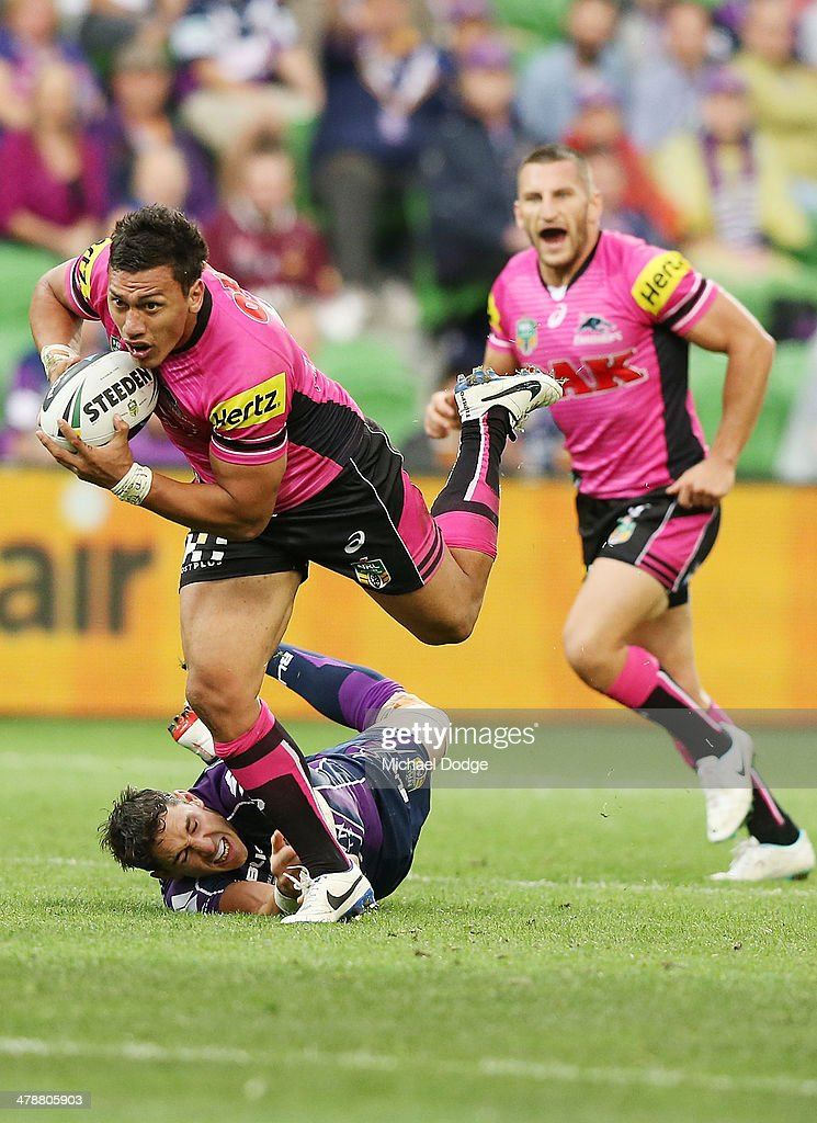 Billy Slater of the Storm tackles Ben Creagh of the Panthers during the round two NRL match between the Melbourne Storm and the Penrith Panthers at AAMI Park on March 15, 2014 in Melbourne, Australia.
