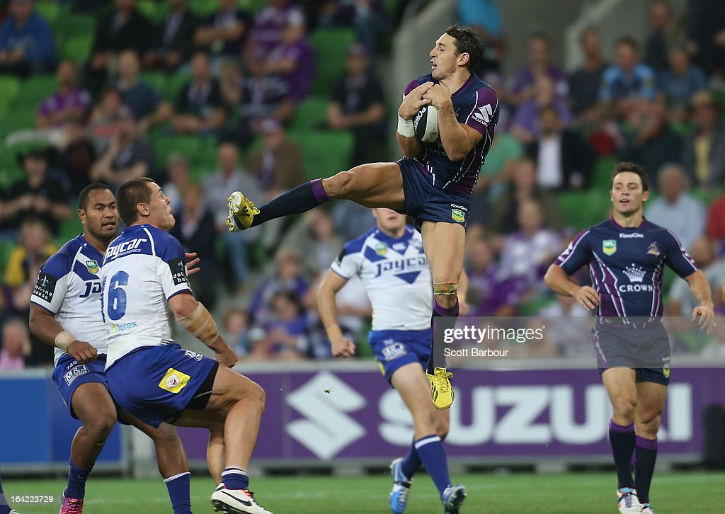 Billy Slater of the Storm takes a high ball and kicks David Klemmer of the Bulldogs in the head during the round three NRL match between the Melbourne Storm and the Canterbury Bulldogs at AAMI Park on March 21, 2013 in Melbourne, Australia.