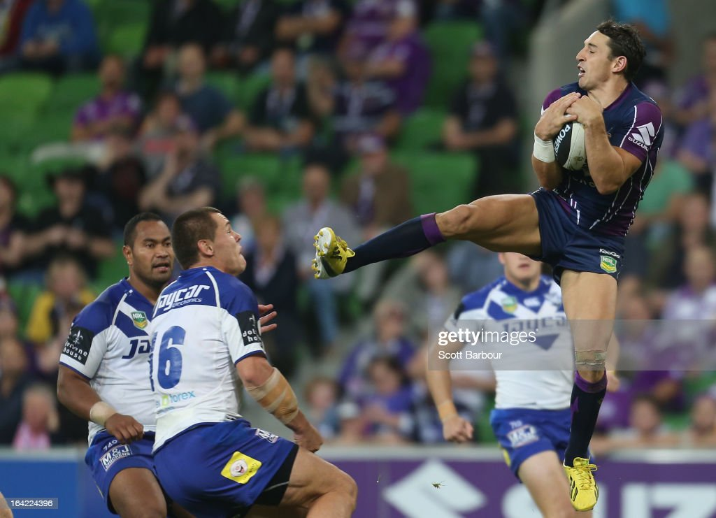 <a gi-track='captionPersonalityLinkClicked' href=/galleries/search?phrase=Billy+Slater&family=editorial&specificpeople=171206 ng-click='$event.stopPropagation()'>Billy Slater</a> of the Storm takes a high ball and kicks David Klemmer of the Bulldogs in the head during the round three NRL match between the Melbourne Storm and the Canterbury Bulldogs at AAMI Park on March 21, 2013 in Melbourne, Australia.