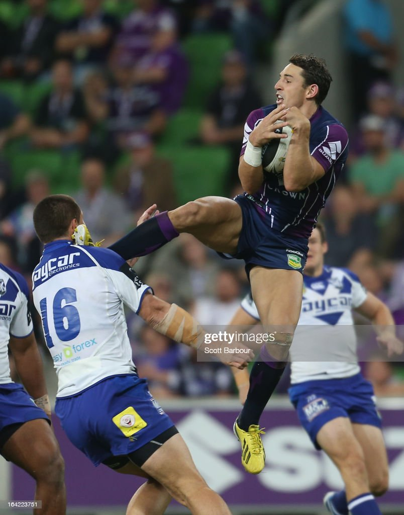 Billy Slater of the Storm takes a high ball under pressure and kicks David Klemmer of the Bulldogs in the head during the round three NRL match between the Melbourne Storm and the Canterbury Bulldogs at AAMI Park on March 21, 2013 in Melbourne, Australia.