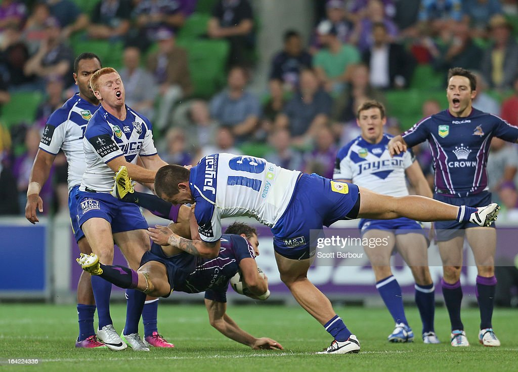 <a gi-track='captionPersonalityLinkClicked' href=/galleries/search?phrase=Billy+Slater&family=editorial&specificpeople=171206 ng-click='$event.stopPropagation()'>Billy Slater</a> of the Storm takes a high ball under pressure and kicks David Klemmer of the Bulldogs in the head during the round three NRL match between the Melbourne Storm and the Canterbury Bulldogs at AAMI Park on March 21, 2013 in Melbourne, Australia.