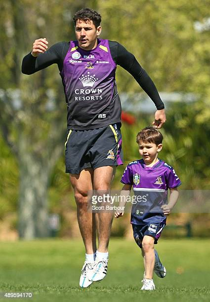 Billy Slater of the Storm trains with his son Jake Slater during a Melbourne Storm NRL training session at AAMI Park on September 23 2015 in...