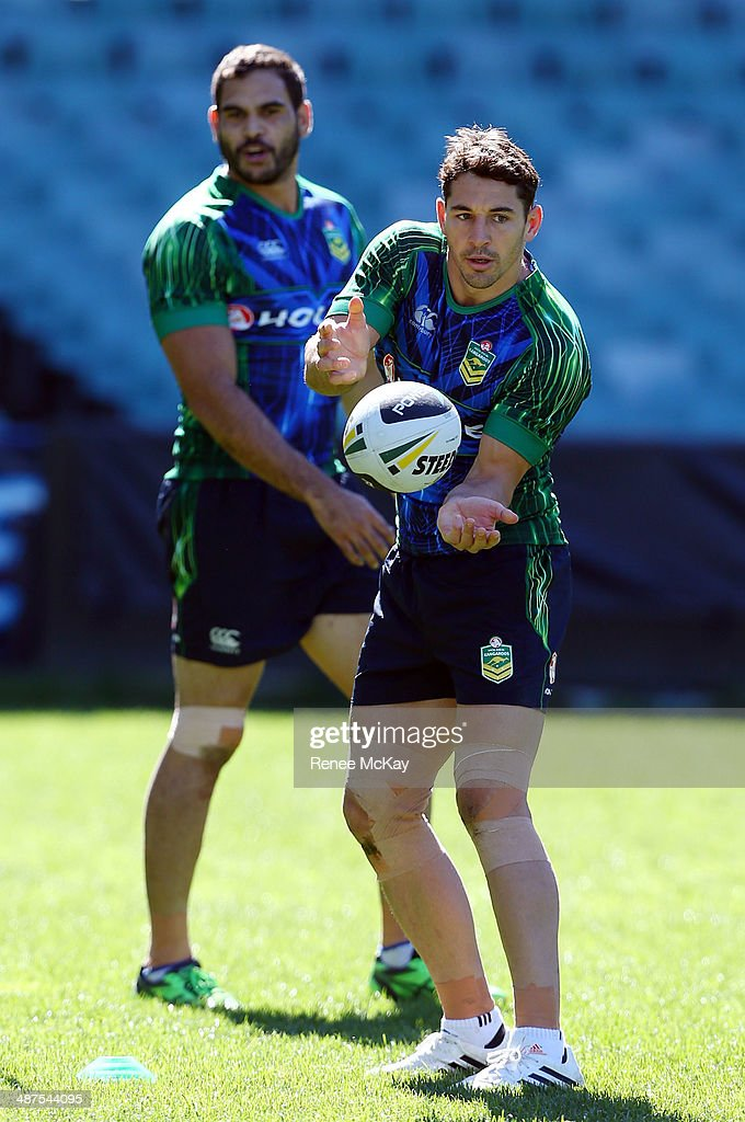 <a gi-track='captionPersonalityLinkClicked' href=/galleries/search?phrase=Billy+Slater&family=editorial&specificpeople=171206 ng-click='$event.stopPropagation()'>Billy Slater</a> passes the ball during an Australian Kangaroos Captain's Run at Allianz Stadium on May 1, 2014 in Sydney, Australia.