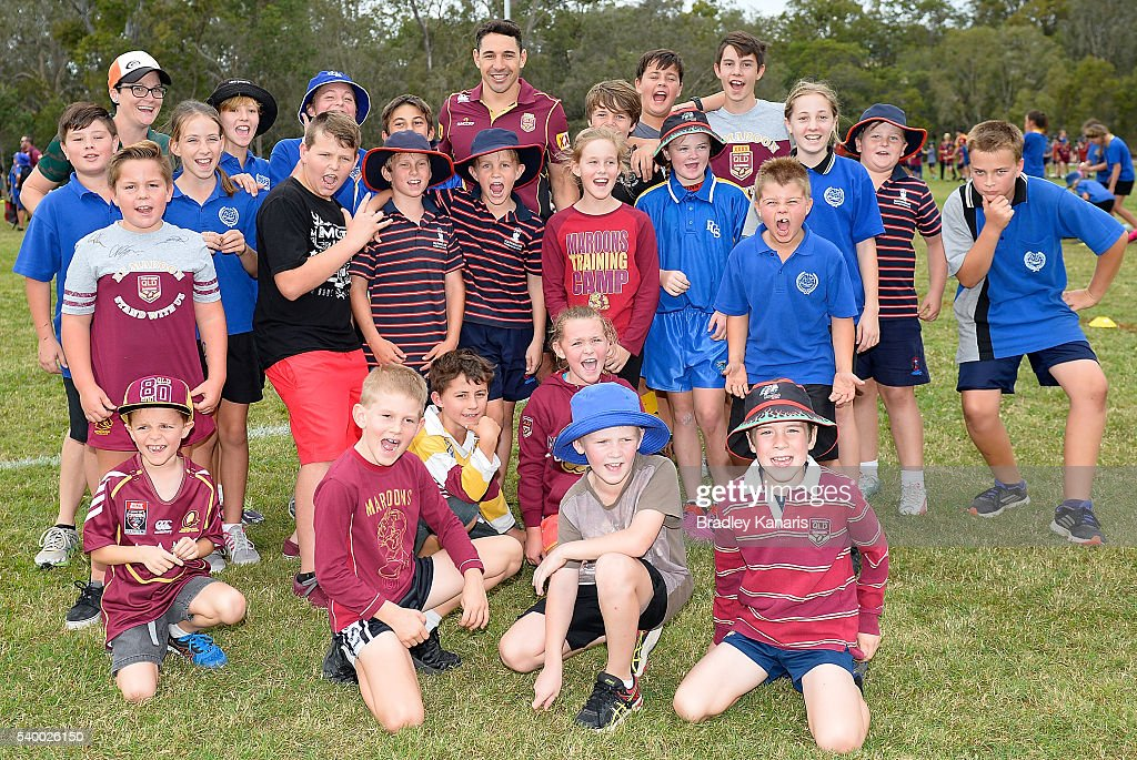 Billy Slater poses for a photo with juniors at a Rugby League Junior Clinic during a Queensland Maroons State of Origin Fan Day on June 14, 2016 in Gladstone, Australia.