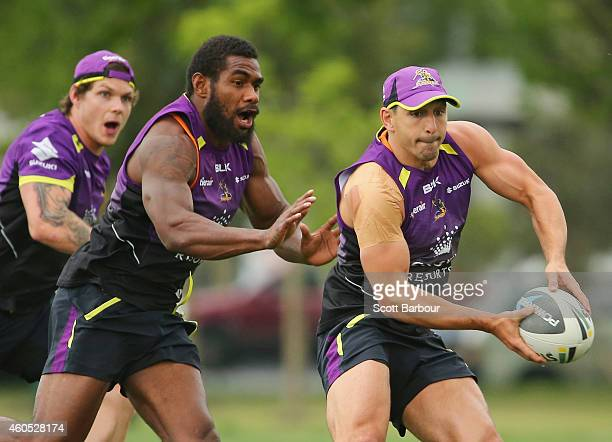 Billy Slater runs with the ball during a Melbourne Storm NRL training session at Gosch's Paddock on December 16 2014 in Melbourne Australia