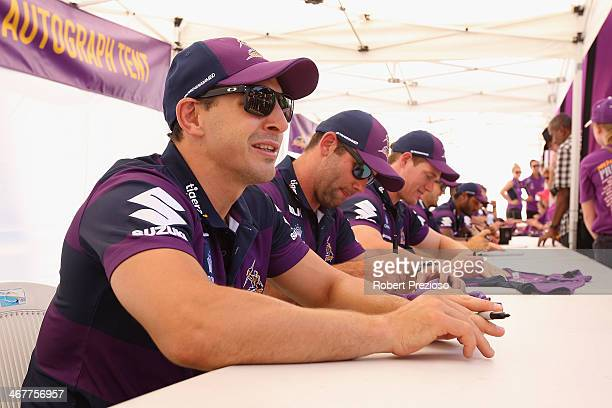 Billy Slater signs autographs during the Melbourne Storm NRL family day at Gosch's Paddock on February 8 2014 in Melbourne Australia