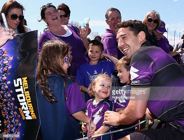 Billy Slater signs autographs for fans during a Melbourne Storm NRL fan day at Gosch's Paddock on September 20 2015 in Melbourne Australia