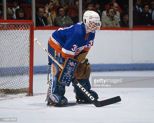 Billy Smith of the New York Islanders follows the action during a game against the Montreal Canadiens Circa 1980 at the Montreal Forum in Montreal...