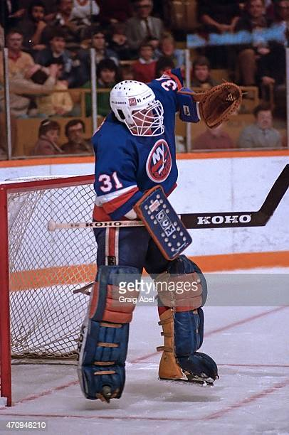 Billy Smith of the New York Islanders makes a save against the Toronto Maple Leafs during game action at Maple Leaf Gardens in Toronto Ontario Canada...
