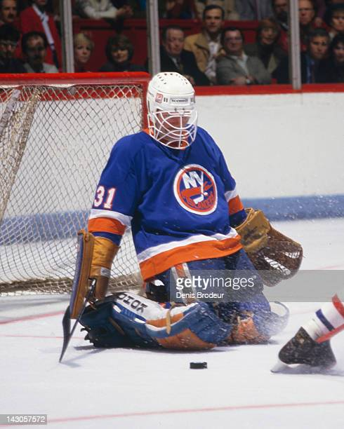 Billy Smith of the New York Islanders makes a save during a game against the Montreal Canadiens Circa 1980 at the Montreal Forum in Montreal Quebec...